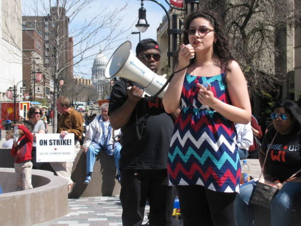 Amy Pérez, a UW-Madison food service worker, talks about managing on $9.75 an hour while going to school at a rally Wednesday on the Library Mall.(photo madison host)
